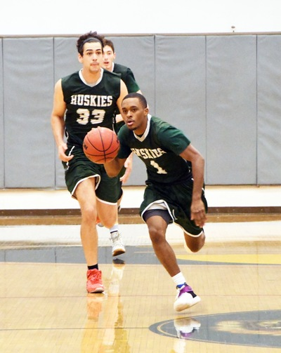 East Los Angeles College sophomore starting guard Robert Fuller (pictured running with the ball from another game) runs on offense with sophomore center Colin Bell closely behind. (Photo by DeeDee Jackson)