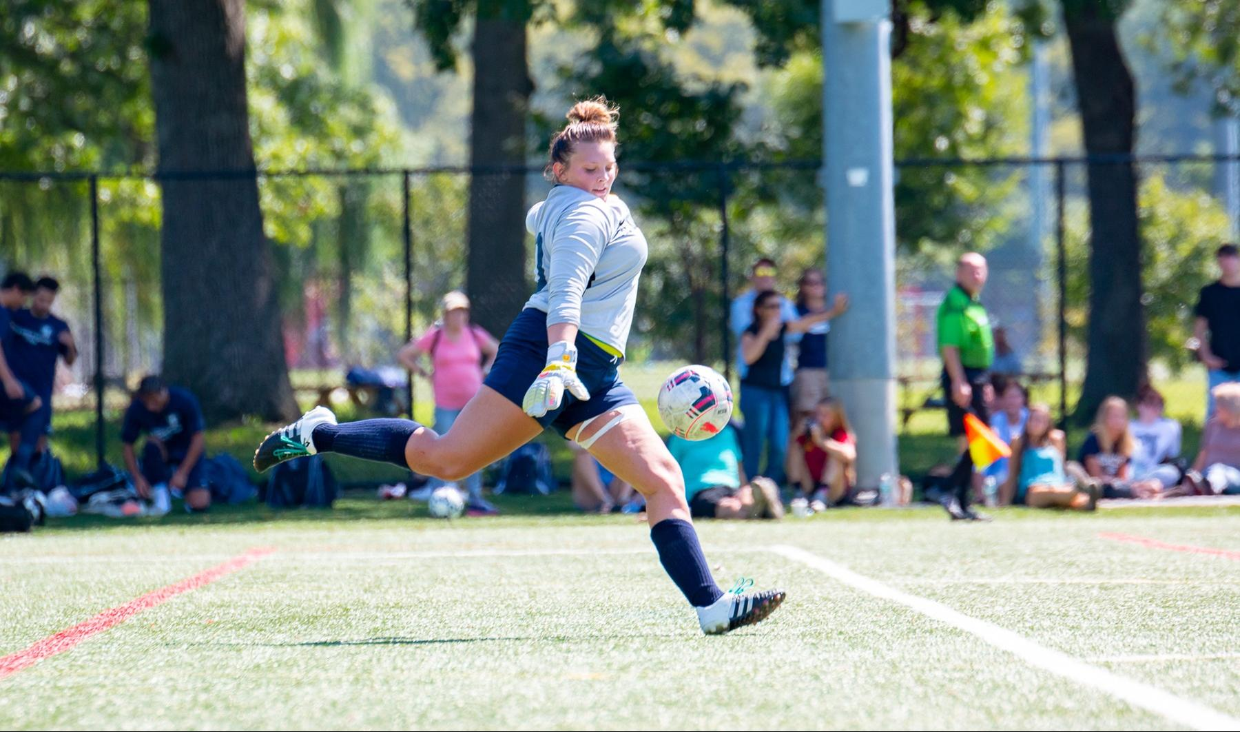 The King's College Women's Soccer goalkeeper Bailey Kaufman punts the ball downfield.