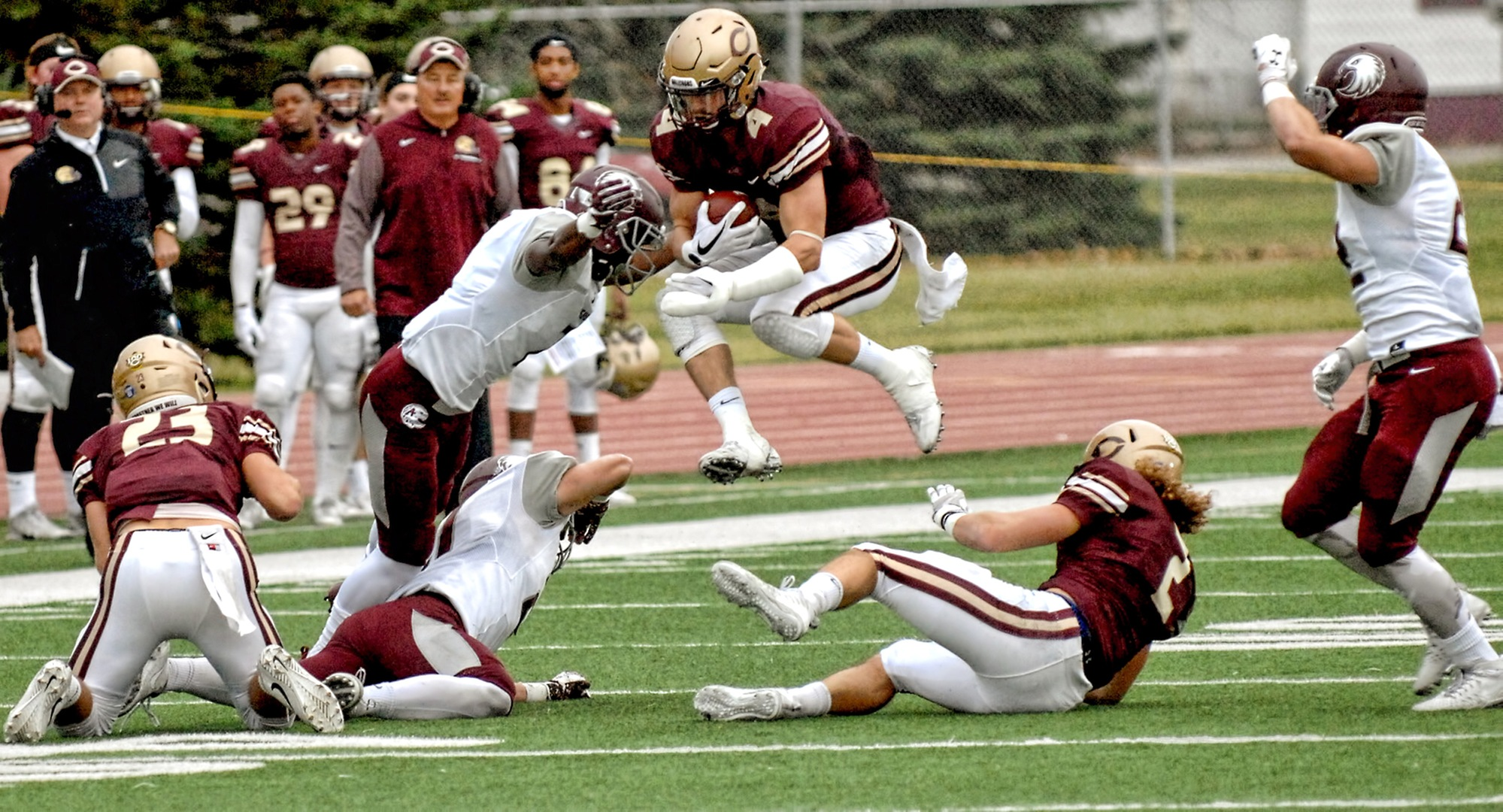 Senior Jason Montoyne flies through the air during one of his nine carries in the Cobbers' 42-20 win over Augsburg.