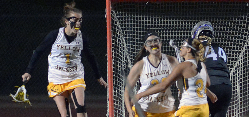 Hannah Albrechta celebrates with Kayla Miller and Brie Martineau after scoring game-winning goal in overtime