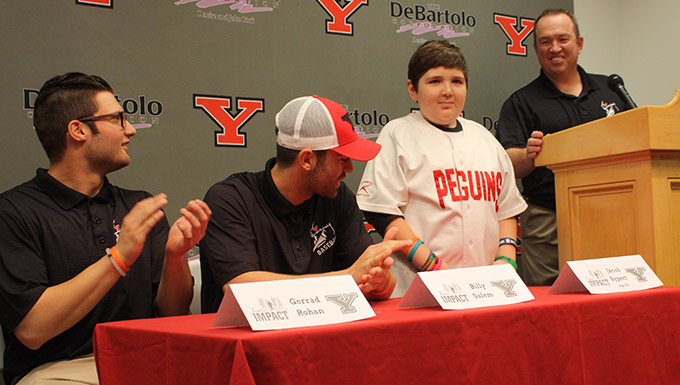 Team IMPACT performer Jacob Sypert officially joined the YSU baseball team. Also pictured are seniors Gerrad Rohan and Billy Salem and head coach Steve Gillispie.