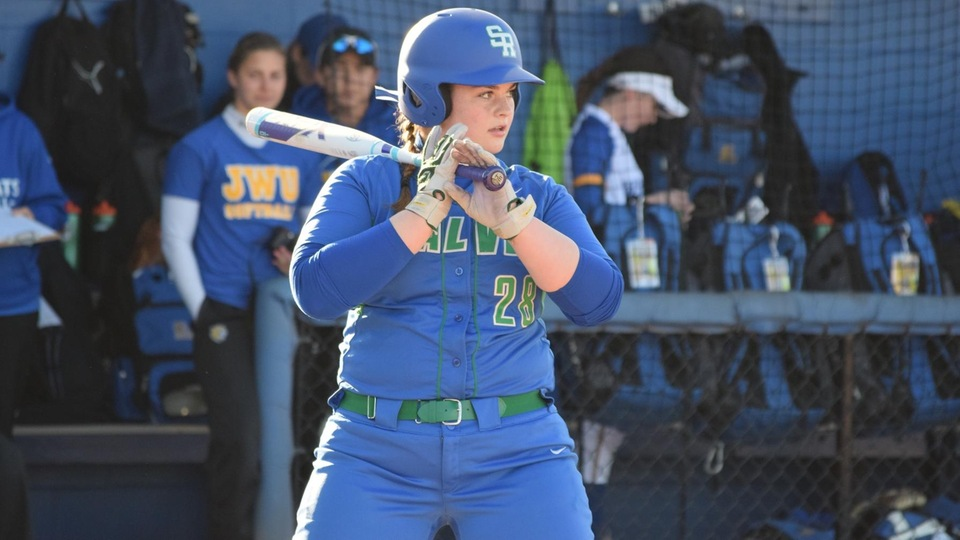 Starting catcher Emily Woznick collected three hits in the season opener for Salve Regina, including a lead-off home run in the top of the second inning. (Photo by Ed Habershaw)