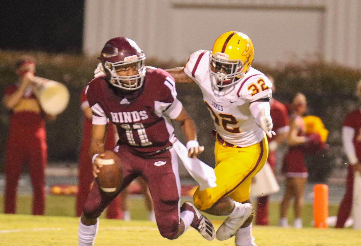 Jones linebacker Mike Cockream (32) rushes Hinds quarterback BeSean McCray (11) Thursday night in Raymond. Photo/Chris Brooks