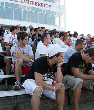 Incoming players listen to staff members talk on Wednesday evening