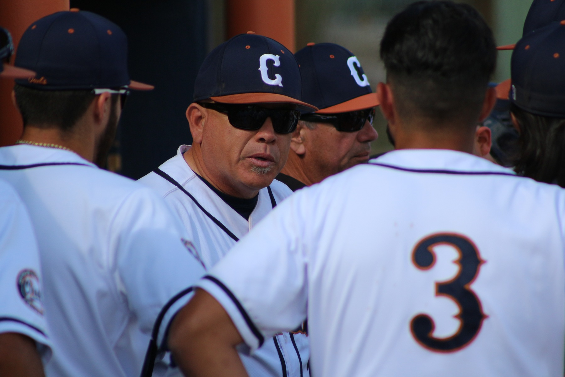 Head Coach Steve Gomez motivating his guys in the dugout.