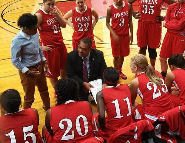 Head coach Mike Llanas talks to his team during a timeout in today's 65-63 loss to Kirkwood Community College. Photo by Kelly Llanas/Owens Sports Information