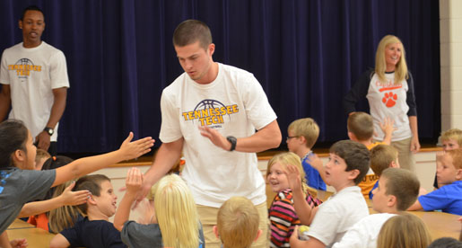 Men's basketball team volunteers at Capshaw Elementary School