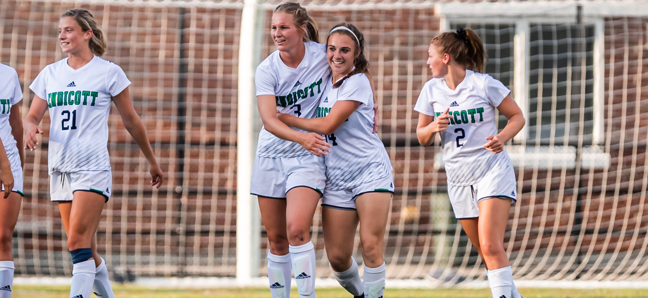 Image of Hannah Lederman, Larissa Cade, Lindsey Papa and Hailey Demers celebrating Papa's game-winning goal over Ithaca.