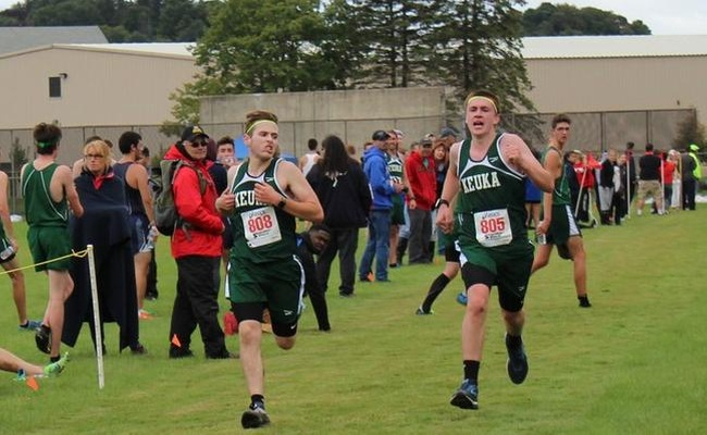 Braxton Knapp (left) set a new personal best in the 8K on Saturday