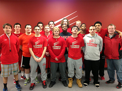"Members of the men's lacrosse team at Wells College pose for a team picture after shaving their faces in advance of ""Mustache March"" in late February. (Courtesy)"