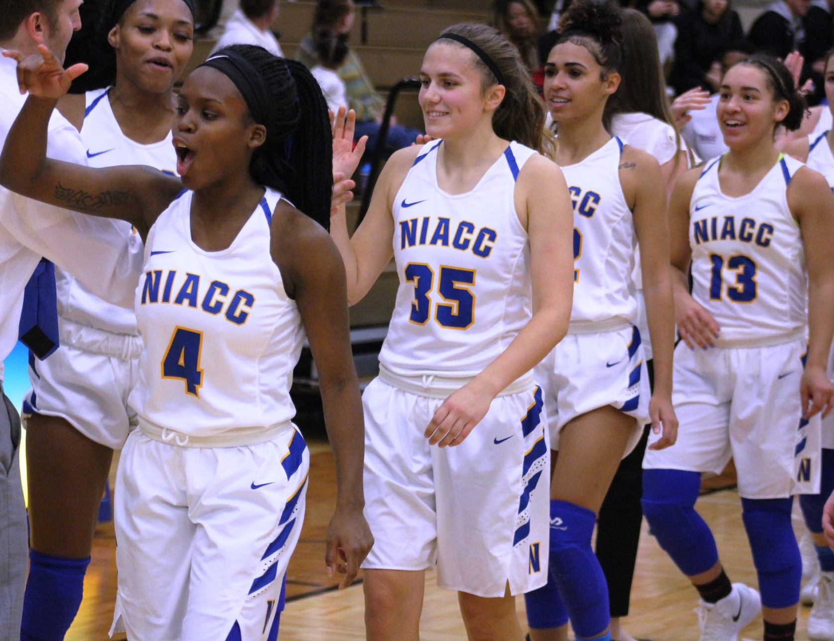 NIACC players are all smiles after Saturday's 98-89 win over Iowa Western in the NIACC gym.