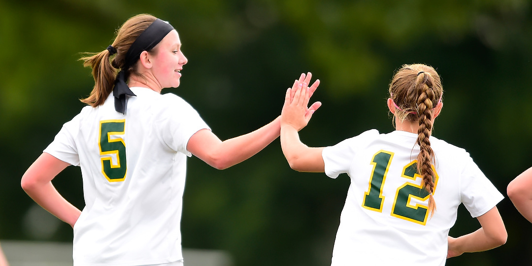 Hannah Schepers high fives Allie Titus after a goal.