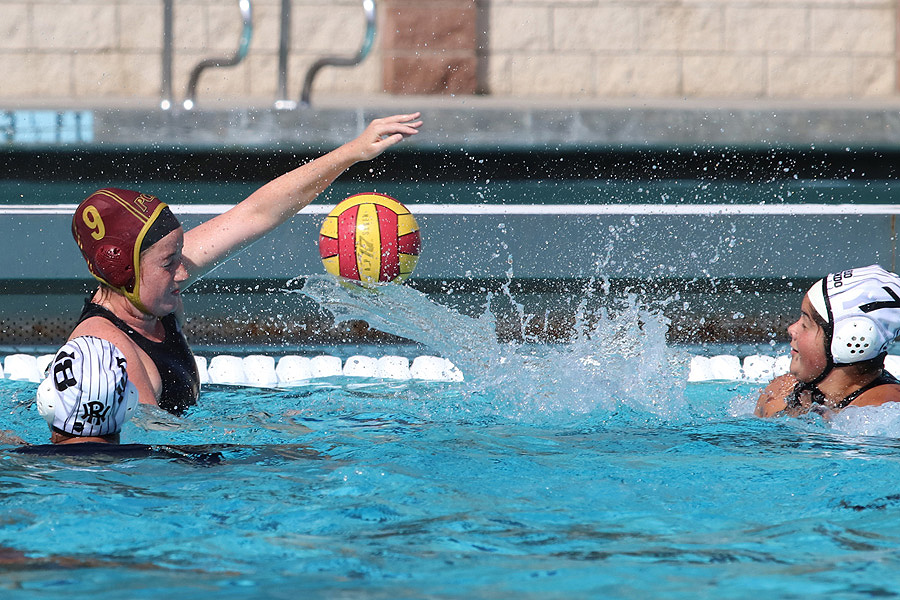 Lancer Camila Grases (red 9) makes the field block on a Rio Hondo shot during Monday's loss at the PCC Aquatic Center, photo by Richard Quinton.