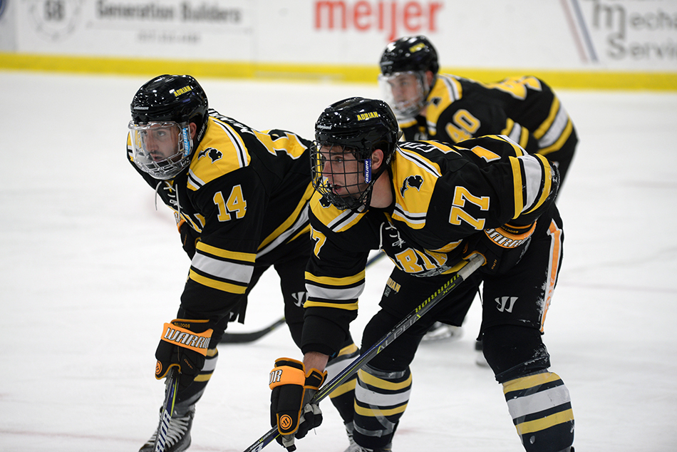 Matt McNair (#14) and Joey Colatarci are set for a face-off while Bryan Yim is pictured in the background. (Action photo by Patrick Stewart)