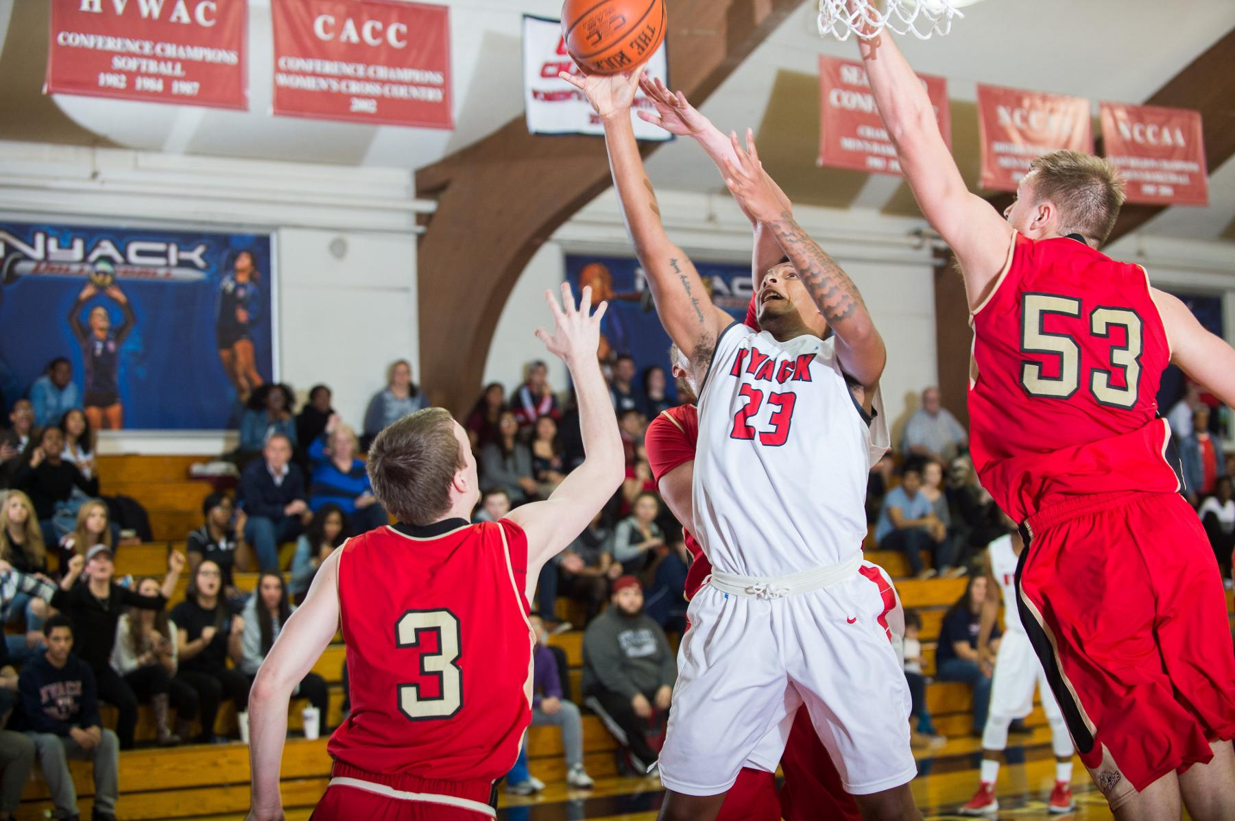 Chandler's Buzzer Beater lifts Men's Hoops Past Assumption