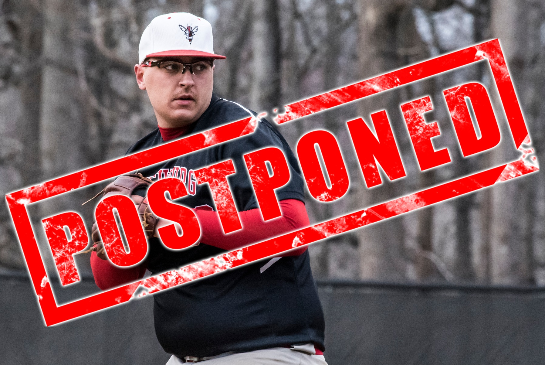 Brady Moore throws a pitch. Text: Postponed.