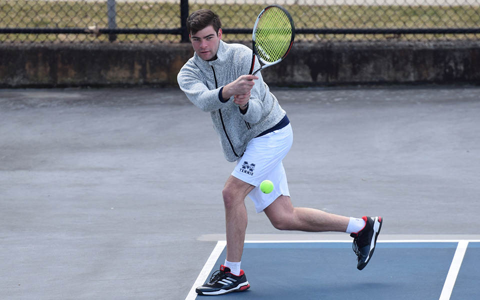 Luke Peterson competes in doubles action versus Rutgers-Camden on Hoffman Courts.