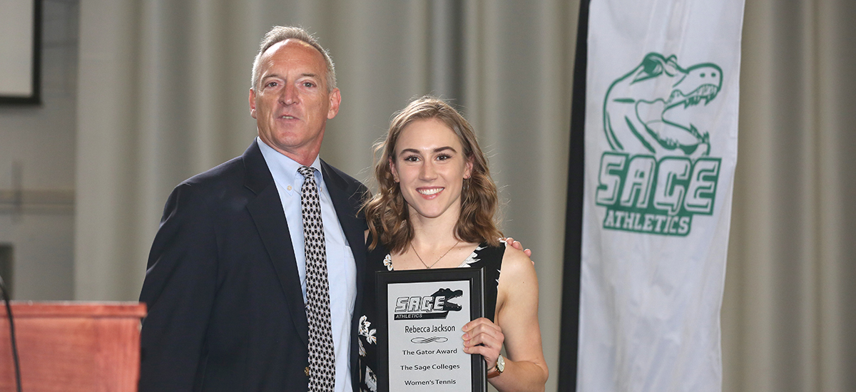 Head Tennis Coach Tom Fashouer presents Rebecca Jackson with Gator of the Year honors.