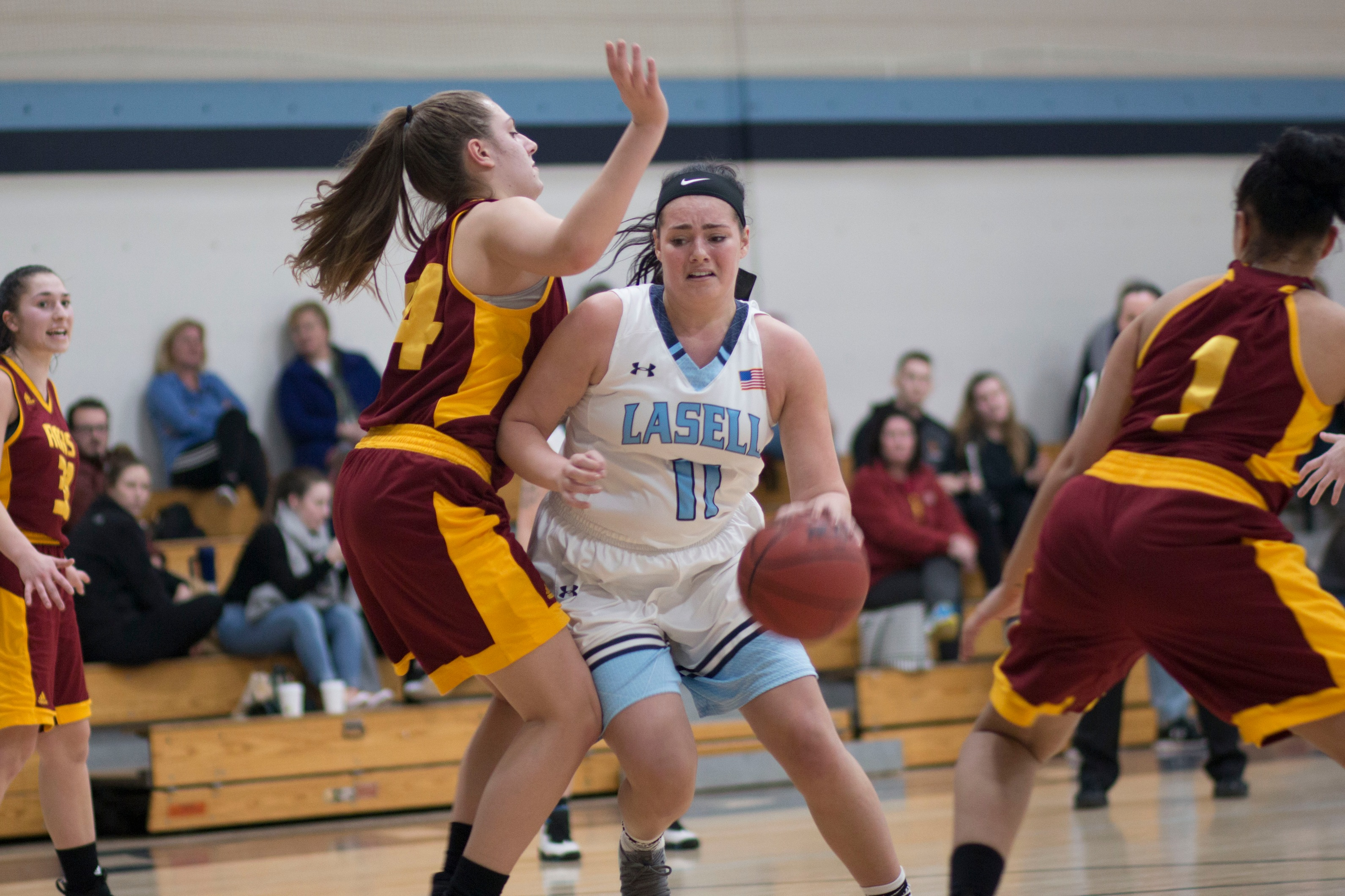 Regis too strong for Lasell Women's Basketball