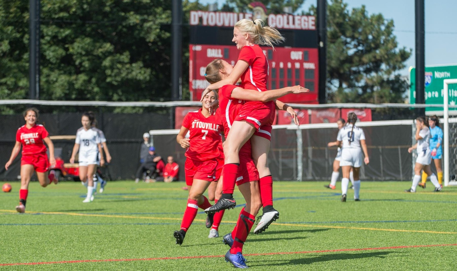 Magee Sisters Shine as Spartans Drop Home Opener in Double OT