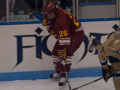 Junior forward Mike Embach recorded his second goal of the series at Notre Dame in Sunday's matchup.  (Photo by Joe Gorby)