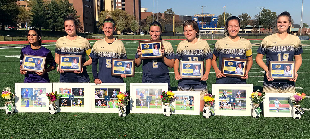 Gallaudet women's soccer seniors gather together on Saturday afternoon at Hotchkiss Field with their senior awards.