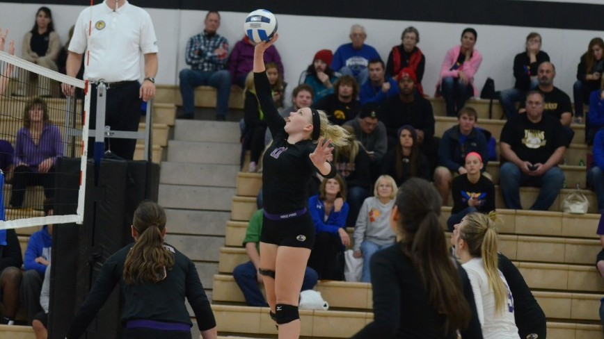 Mary Goergen hits it over the net.