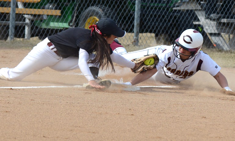Madison Little tries to avoid the tag on a stolen base attempt in the first game vs. VCSU. Little went 4-for-7 on the day.