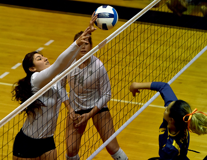 Megan Martinez with her only solo block of the match. She would assists with five other blocks on the night.