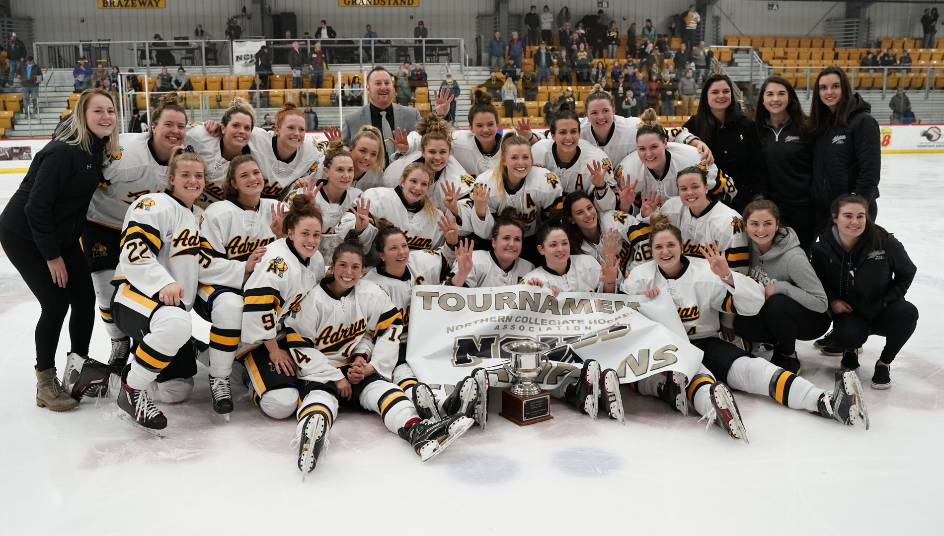 Adrian celebrates winning the Slaats Cup after defeating St. Scholastica 3-2 in double overtime on Sunday (Photo by Mike Dickie).