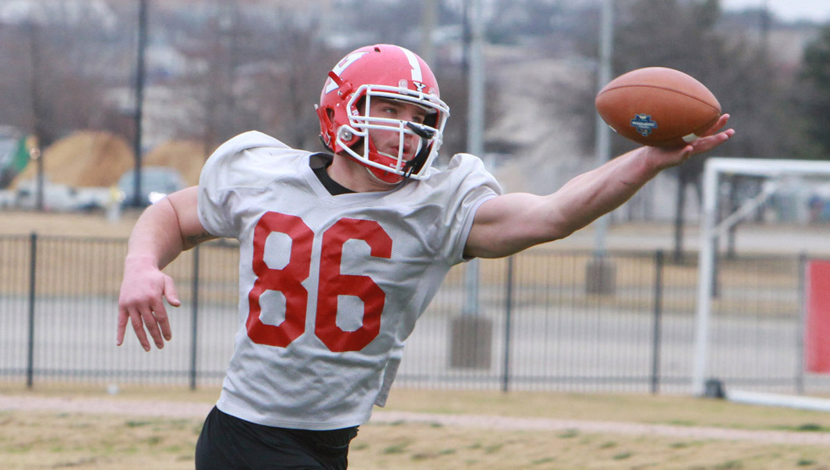 Shane Kuhn makes a grab at practice on Thursday in Frisco, Texas.