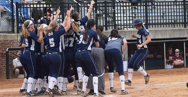 The Greyhounds greet Kat Spilman '19 at the play after a go-ahead two-run homer versus Salisbury in Game 6 of NCAA Division III Ewing, N.J. Regional