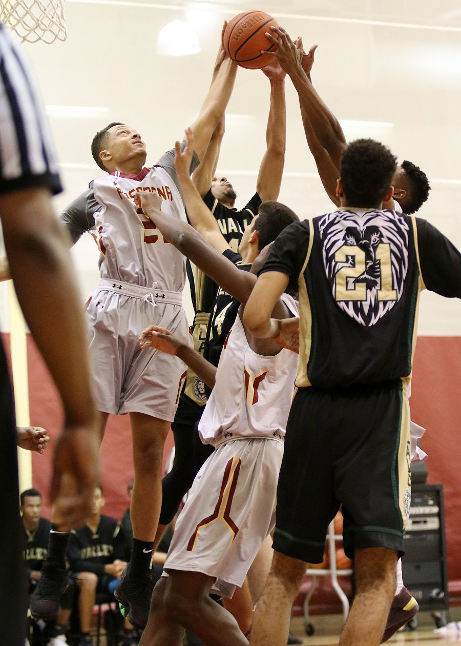 Chris Blount goes up for a rebound in PCC's win over LA Valley Friday night, photo by Richard Quinton.