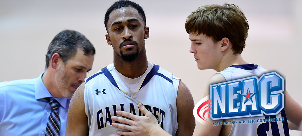 Gallaudet's Jawaun Jackson (center) is sad after a game as he walks off the court. A teammate tries to console Jackson.