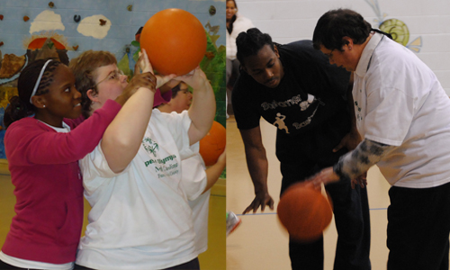 Micheala Watkins and Donald Hudson help the Special Olympics athletes as they practice at Brevard Elementary