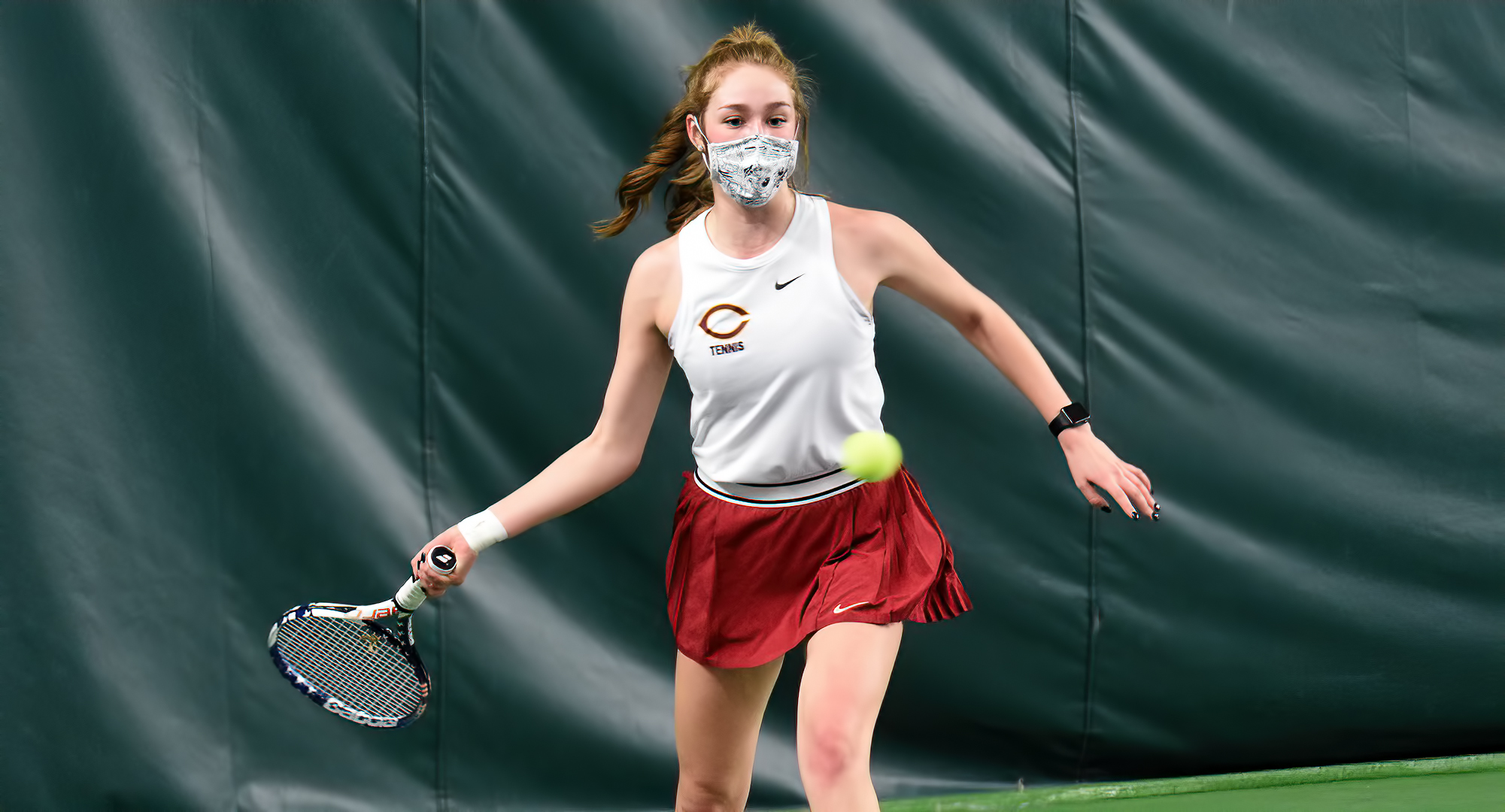 Sophomore Raquel Egge eyes a forehand return during her No.1 singles match against Gustavus on Friday.