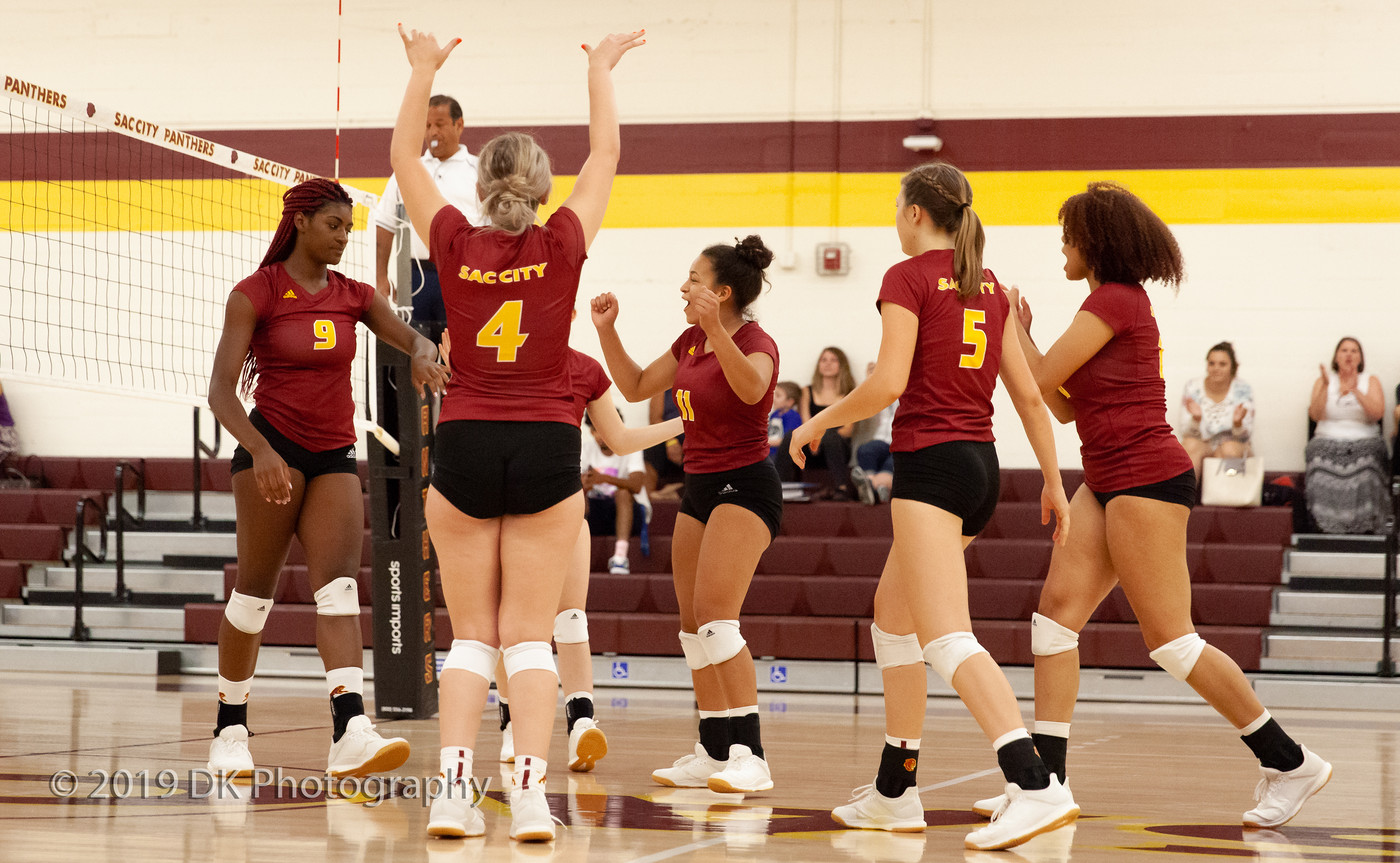 City College volleyball celebrates after a spike by Jaylah Tate (#9) in the match against Redwoods College in the North Gym on Sept. 4th.
