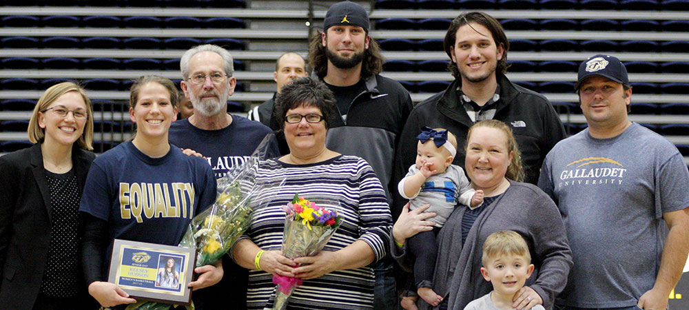 Gallaudet's Kelsey Hudson (left) with Head Coach Stephanie Stevens (far left) and the rest of the Hudson family on Senior Day.