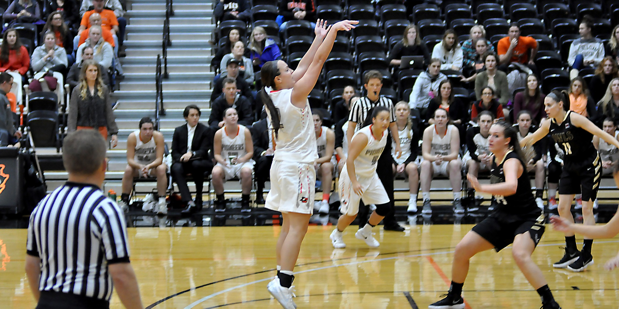 Wood opens with double-double, Leith scores 15 as Pioneers drop debut