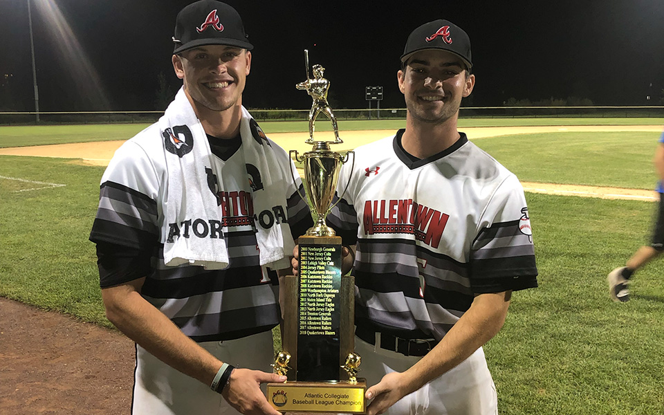 Eddie Olsen '22 and Ian Csencsits '20 with the Atlantic Collegiate Baseball League championship trophy after helping the Allentown Railers win the eight-team, wood bat league title on August 6.