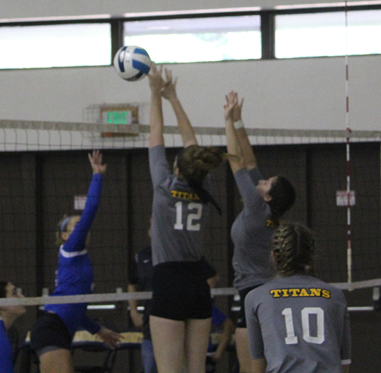 #12 Amanda Turnbull and #8 Jessica Straub going up for a block (photo courtesy of CCBC Essex Athletics Dept)