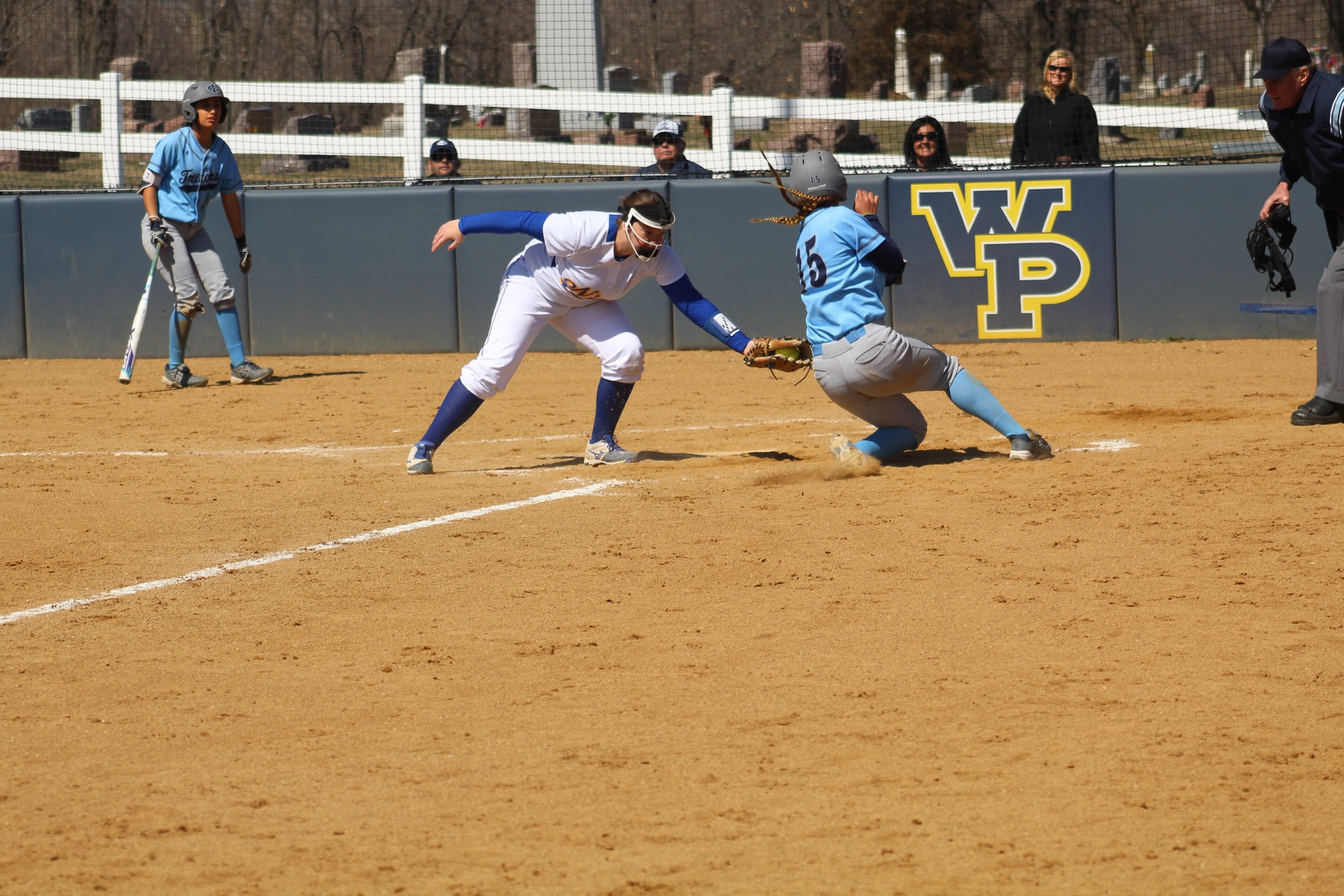 NIACC pitcher Courtney Johannes tags out Iowa Central's Alyssa Dema in the first game of Friday's doubleheader.