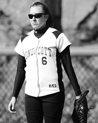 Black and white action photo of Ashley Wright playing softball