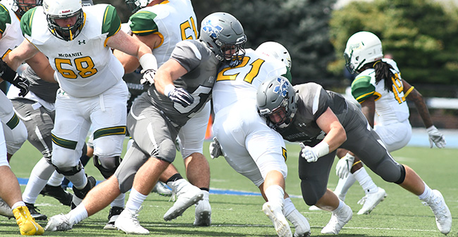 Nick Tone '19 and Shane Mastro '21 combine on a tackle against McDaniel College on Rocco Calvo Field.