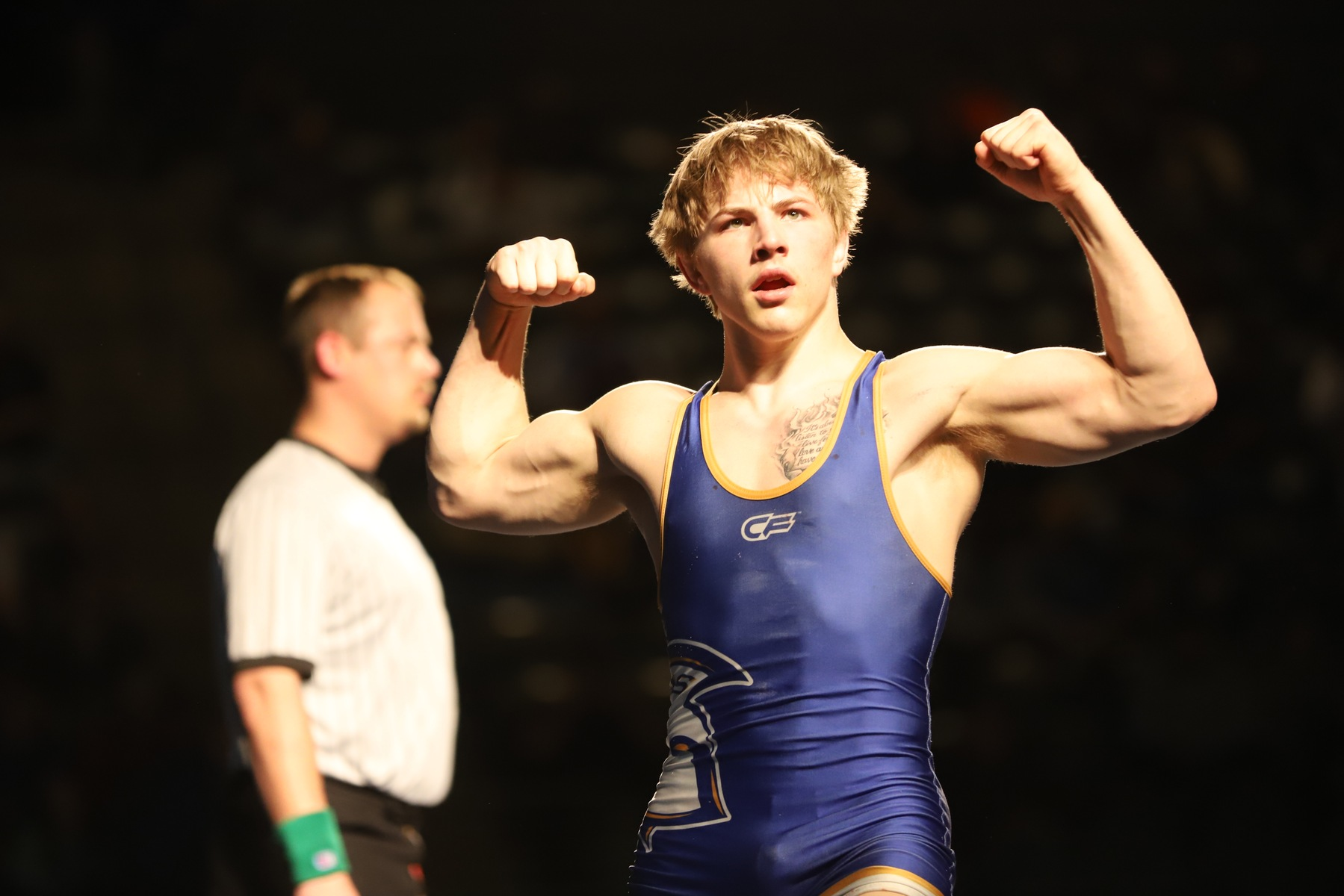 NIACC's Austin Anderly flexes after winning the 141-pound national title Saturday night. Photo by Paul DeCoursey.