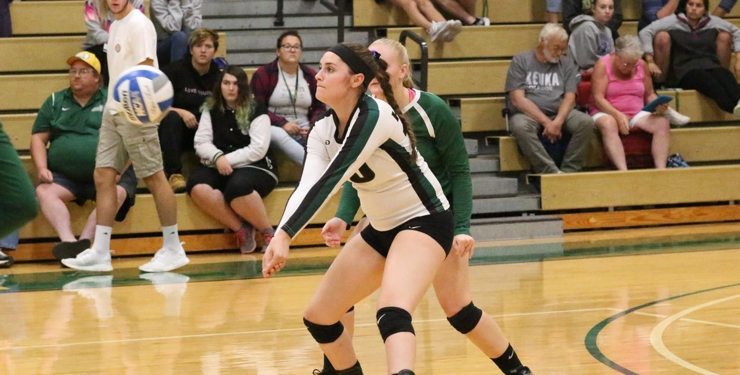 Senior Emily Cottrell (10) had a combined 28 digs and 8 aces on Saturday -- Photo by Ed Webber