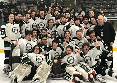 Travis Rybchinski (right, 3rd row) has led DCB to Back-to-Back National Championships