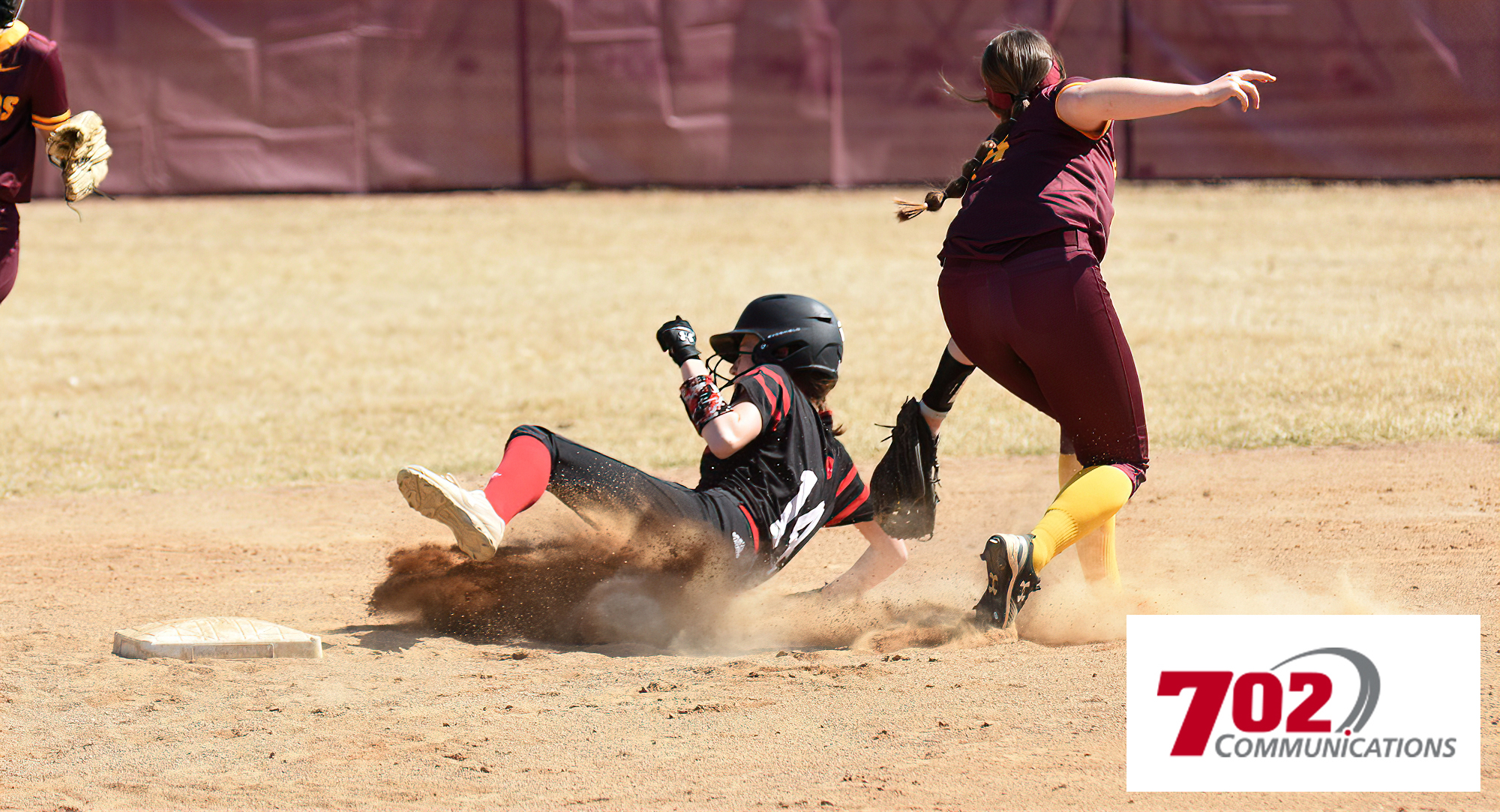 Cobber junior shortstop Kate Wensloff applies the tag to a would-be St. Ben's base stealer in the first game of the doubleheader. (Pic courtesy of Sheldon Green)