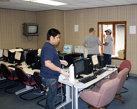 Gallaudet student-athletes clean and fix up old computers.