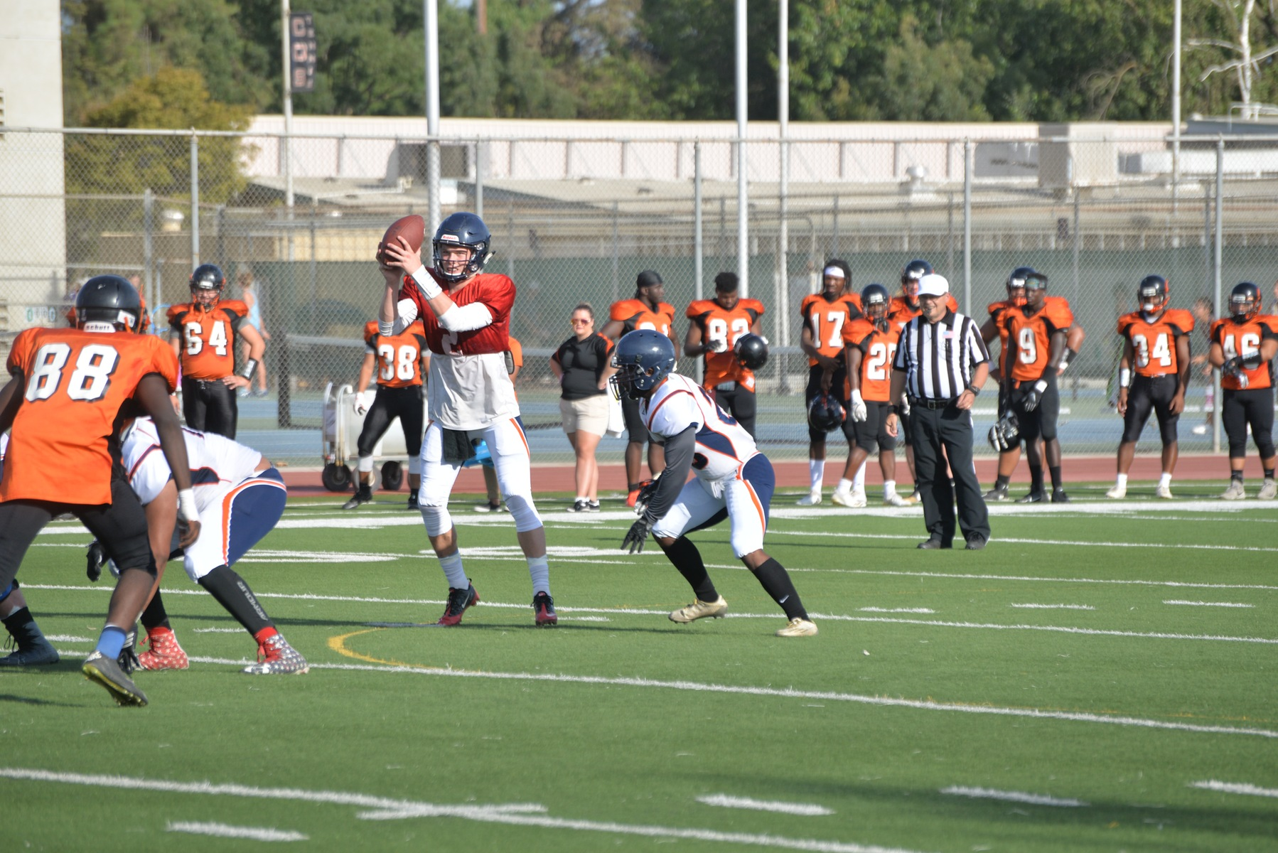 Starting QB Ryan Johnson takes a snap earlier this season in a scrimmage versus Reedley College.